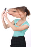Girl with big distorted head taking selfie. Close up. White background. Royalty Free Stock Photography