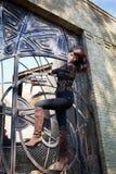 Girl with big eyes on lattice wrought iron gates Stock Photography