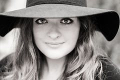 Girl with big eyes. Portrait of a young beautiful lady with big eyes in black hat Stock Photography