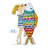 Girl and big fish Stock Photos