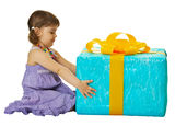 Girl with a big gift box on white background Stock Photos