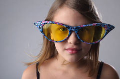 Girl in big glasses. Stock Image