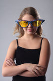 Girl in big glasses. Royalty Free Stock Photography