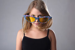 Girl in big glasses. Royalty Free Stock Images