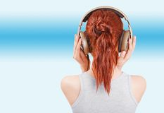 Girl in big headphones Royalty Free Stock Image
