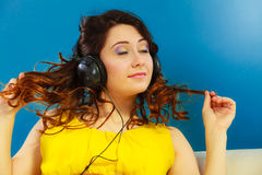 Girl in big headphones listening music mp3 relaxing Royalty Free Stock Images