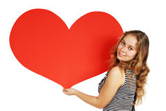 Girl with a big heart. Young woman holding a heart on Valentine's Day Royalty Free Stock Image