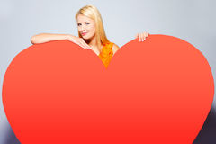 Girl with big heart. Stock Images
