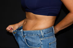 Girl with big jeans after diet Stock Photos