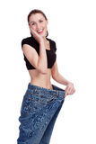 Girl in big jeans Stock Photo