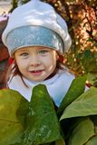 Girl with the big leaves Stock Image