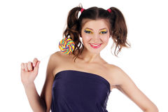 Girl with big lollipop Stock Photos
