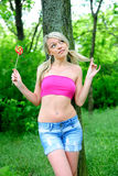Girl with big lollipop. Royalty Free Stock Image