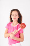 Girl with a big lollipop Royalty Free Stock Photography