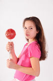 Girl with a big lollipop Stock Photos