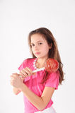 Girl with a big lollipop Stock Photography
