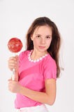 Girl with a big lollipop Royalty Free Stock Images