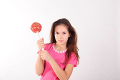 Girl with a big lollipop Royalty Free Stock Image