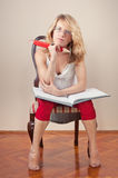Girl with big notebook and big red pencil Stock Images