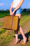 Girl with big old suitcase Royalty Free Stock Photography