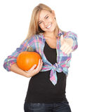 Girl with big orange pumpkin and thumb up Royalty Free Stock Images