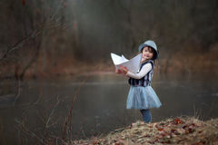 Girl with big paper boat Royalty Free Stock Images