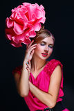 Girl with big pink flower on head Royalty Free Stock Photo