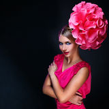 Girl with big pink flower on head Stock Photo