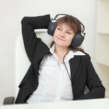 Girl with big professional ear-phones on head Stock Images