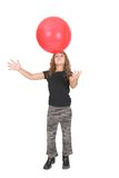 Girl and big red ball Stock Photos
