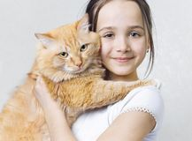 A girl with a big red cat. In her arms Stock Photos