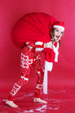 Girl with big red christmas bag Royalty Free Stock Photography