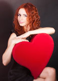 Girl with big red heart Royalty Free Stock Image