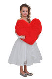 Girl and a big red heart. Girl in white dress holding a big red heart Stock Photo