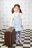 Girl with the big road suitcase Royalty Free Stock Image