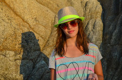 Girl and big rock Stock Images