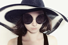 Girl in big round sunglasses and summer hat Royalty Free Stock Photography