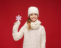 Girl with big snowflake Royalty Free Stock Photo
