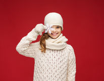 Girl with big snowflake. Winter, people, happiness concept - girl in hat, muffler and gloves with big snowflake Royalty Free Stock Image