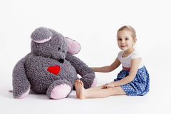 Girl with big soft toy mouse. Little baby girl with big soft toy mouse with heart Royalty Free Stock Photo