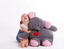 Girl with big soft toy mouse. Little baby girl with big soft toy mouse with heart Royalty Free Stock Photos