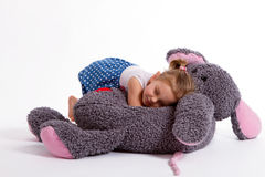 Girl with big soft toy mouse. Little baby girl with big soft toy mouse with heart sleeping Royalty Free Stock Images