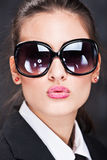 Girl with big sun glasses sending kiss Royalty Free Stock Photography