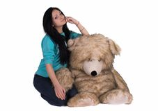 Girl with big teddy bear. studio shot Stock Photography