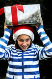 Girl with big xmas present Stock Photos