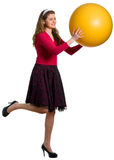 Girl with the big yellow ball Royalty Free Stock Images