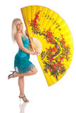 The girl with the big yellow fan Royalty Free Stock Photography