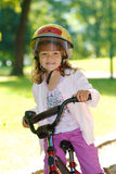 Girl on a bike Stock Images