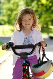 Girl on a bike Royalty Free Stock Photo