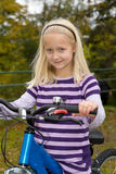 Girl with a bike Stock Photo